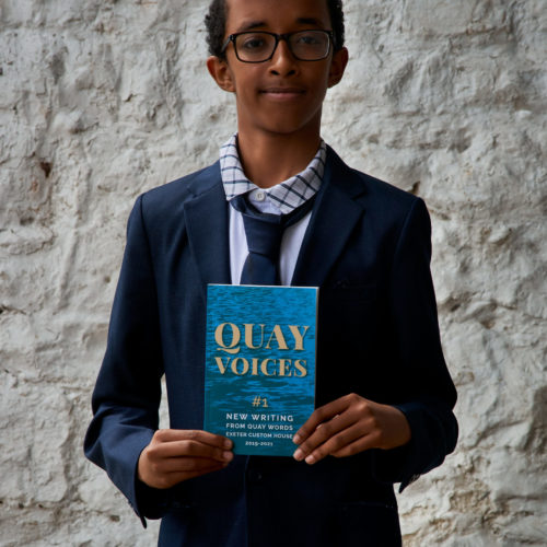 Mohamed Yahie proudly displays his copy of Quay Voices #1